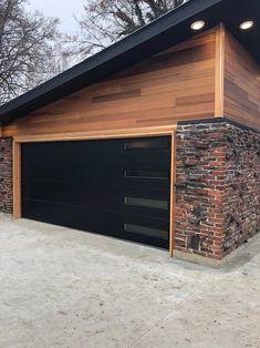 BOISE BOYS A black garage door nicely complements the brickwork, trim and wood. Black Garage Doors, Modern Garage Doors, Best Garage Doors, Wood Garage Doors, Plan Garage, Garage Shed, Garage Ideas, Diy Garage, Garage Kits