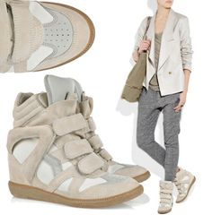 High-top, multi-colored suede sneaker with hidden wedge heel and velcro strap detail. This sneaker will add 3.5 inches to your height and comfortable.