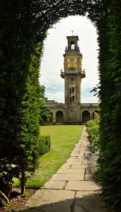"""This 100-foot (30m) clock tower was added to Cliveden Mansion in 1861 and is the work of the architect Henry Clutton. As a functioning water tower it still provides water for the house today. It is rendered in Roman cement like the rest of the house, and features four clock faces framed by gilded surrounds and a half open staircase on its north side. It was described by the architectural critic Nicholas Pevsner as """"the epitome of Victorian flamboyance and assertiveness."""" The tower i..."""
