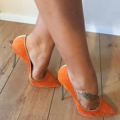 Orange suede pumps, arches, toe cleavage, and nice tat