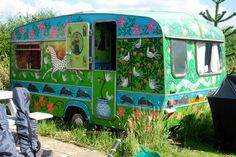 """A vintage/retro touring caravan hand painted by folk artist Emma Stubbs-Hunk 