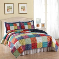 Introduce your bedroom to the cosy warmth of a bygone era with this traditional Halifax cotton quilt set. This multi-color, patchwork-square set is available in twin size with one pillow sham, and queen and king sizes with two shams.