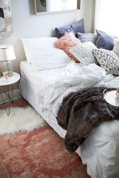 5 Tips For Hosting Overnight Guests - Haute Off The Rack White Faux Fur Rug, White Fur, Extra Bedroom, Bedroom Bed, Rose Gold Kitchen, Pinterest Home, Fur Throw, Throw Pillows, Houses