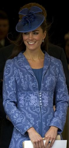 A closeup version of Catherine, Duchess of Cambridge leaving St. George's Chapel…I believe the ginger halo surrounding Catherine's hat is Prince Harry!