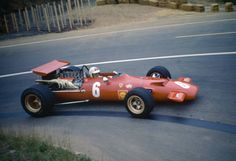 New Zealand racing driver Chris Amon drives the Scuderia Ferrari SpA SEFAC Ferrari 312/69 Ferrari 255C 30 V12 in the 1969 French Grand Prix at the...