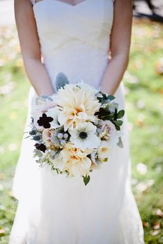October wedding bouquet with dahlia, anemone, thistle, roses, cosmos and brunnia