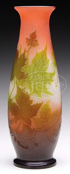 "GALLE CAMEO LEAF VASE. Galle vase is decorated with amber and green cameo glass oak leaves surrounding the body of the vase against a frosted pink and white shaded background. The vase is signed on the side in cameo ""Galle""."