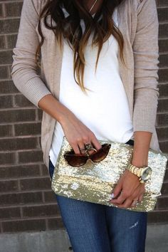 When you just wanna dress up a casual look a bit, add a bold accessory like this big gold clutch.
