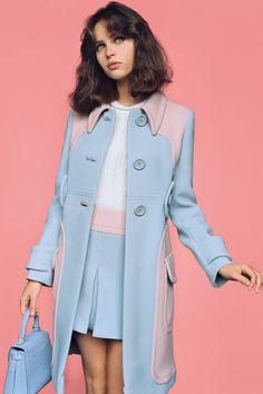 Wool coat and miniskirt, Miu Miu. Sleeveless silk blouse, Saint Laurent <3
