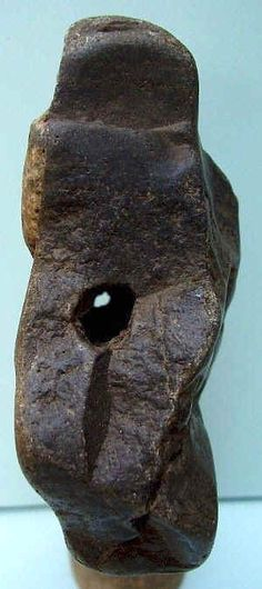 """Venus"""", height 8 cm (3.2""""), putatively ca. 450,000 years BP. The drilled hole through it is an interesting feature."""