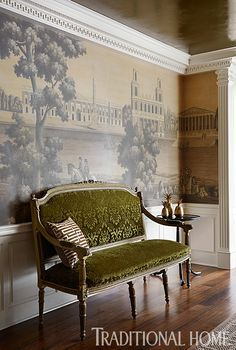 A settee, upholstered in a lush green antique fabric is a polishing touch along one dining room wall. - Photo: Werner Straube / Design: Corey Damen Jenkins