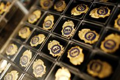 Miniature DEA badges are displayed for sale in the gift shop at the U.S. Drug Enforcement Administra... - Jonathan Ernst/Reuters
