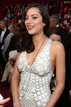 The Best Actress winner for playing Edith Piaf in 'La Vie en Rose,' Marion Cotillard channeled a modern mermaid in her intricately detailed custom-made Jean Paul Gaultier gown, Chopard diamond necklaces – set with 170-carats of diamonds – and ring.