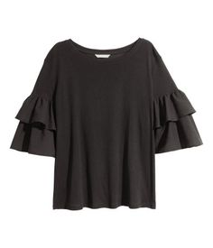 Black. Top in airy cotton jersey with a wide neckline and two flounces in woven fabric on sleeves.