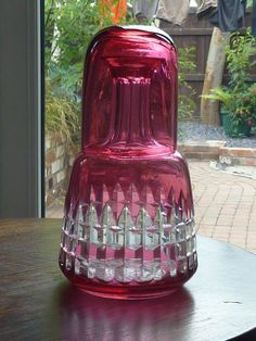 Late Victorian cranberry bedside  water carafe and glass
