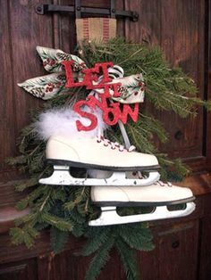 """Let it snow"" door decor with ice skates.  I picked up a pair at the thrift store for 4 bucks back in the Spring.  Can't wait to make my version of this!"
