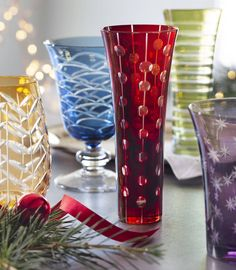 Fiesta's brilliant colored glass captures the play of light in these beautiful, artistic wine glasses. Each glass is colored with dots, stripes and arcs etched into the glass, and are available as flutes, tumblers, goblets and stemless wine glasses.