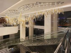 The staircase in JW Hotel Mariott in Hanoi takes guests on a red-carpet treatment under hand blown crystal pieces graduating from clear to light to dark amber. #light #lighting #design #designlighting #interior #interiortrends #crystal #bohemiancrystal #chandelier #hospitality #hotel #staircaselights #staircaselighting #lightinginspirations #lightingtips #preciosa #preciosalighting #preciosainspirations