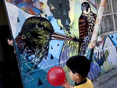 Paintings by street artists cover the walls of a home in Valparaíso, CHILE. Art is embraced in the seaside city, which retains a bit of a bohemian vibe. Photograph by Ivan Kashinsky, Panos Pictures. 365 Photo, Image Caption, Street Artists, National Geographic, Vibrant, Walls, Bohemian, August 19, The Incredibles
