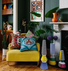 Colour crushing in this vibrant living room. The dark walls are given huge pops of colour with colourful cushions, maximalist vases and bold accessories like this bright orange jug on the mantlepiece. Colourful Living Room, Living Room Green, Living Room Colors, My Living Room, Home And Living, Living Room Designs, Jungle Living Room Decor, Bright Living Room Decor, Dark Green Walls