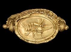 Greek Olbian Gold Seal Ring, 7th-5th Century BCWith a locust motif; inset carnelian panel with intaglio motif of a cockerel standing on an ear of wheat with a mouse in its beak. The ring was used as a...