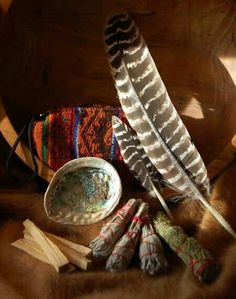 Turkey feather and smudge pot.