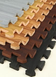 Interlocking Faux Wood Puzzle Mats!!  I bring these in the kitchens of my clients homes so my back doesn't hurt so much cooking all day. I'd love some of these instead of my kid colored ones!