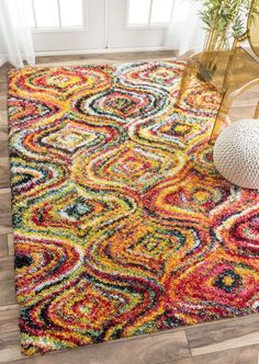 Bring elegance and style to your interiors, with this 100 percent polypropylene, machine woven shag rug. The multi-color adds the perfect bohemian touch besides featuring a durable, dense, soft high pile, which is suitable for high traffic areas of the house.