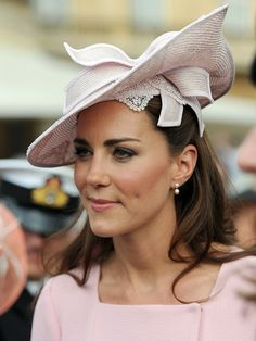 Catherine, Duchess of Cambridge meets guests during a garden party at Buckingham Palace on May 29, 2012 in London, England.