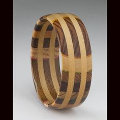 Bracelet | Martha Collins.  It has different end-grain patterns of Zebrawood, Lacewood, Pau Ferro and paired with Boxwood bands