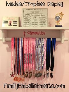 Display for kids trophies & medals. Could also decorate & sit a cork board on top to display ribbons as well. Trophy Shelf, Trophy Display, Award Display, Baseball Display, Gymnastics Bedroom, Gymnastics Crafts, Trophies And Medals, Ribbon Display, Dance Rooms