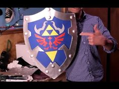 HOW TO: Link's Hylian Shield from ZELDA /// yup pretty kool. ill be making this for my room. mmhhhmmm.