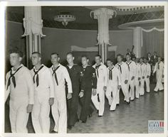 Navy men walking across a ballroom during Boat School Graduation In Louisiana on 5 May 1943. Gift of Louis Gilmore, from The Digital Collections of the National WWII Museum. 2008.379.033.