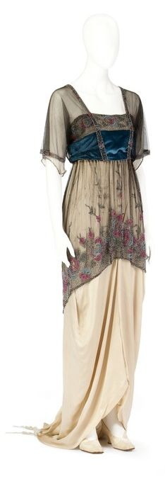 That little bit of blue on this cream colored dress completes the look.   Evening dress, c. 1915, from the Hallwyl Costume Collection.