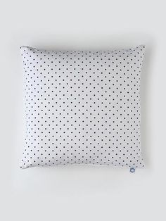 Pegboard cushion from homebase collections. This is a simple, timeless and sophisticated pattern which links to the lights.