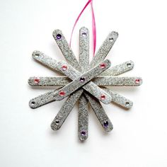 How to Make Popsicle Stick Ornaments (That Don't Look Like Popsicle Stick Ornaments) | Martha Stewart Living - Popsicle sticks make a cool winter comeback with these sparkly snowflake ornaments!