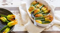 Zucchini flowers stuffed with herbs and rice   A wholesome Greek dish of stuffed zucchini flowers, using a filling of rice, tomato, dill and mint. Listen as Susie Rerakis breaks down her very own recipe.