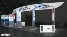 Gamma Meccanica - 20x60 - trade show exhibit. This large island exhibit is the perfect branded environment for the trade show floor. Featuring a large fabric sign/structure, this exhibit is built to facilitate an open, consultative layout and includes backlit information banners, counters and closet with secure storage and integrated TV monitor mounts.