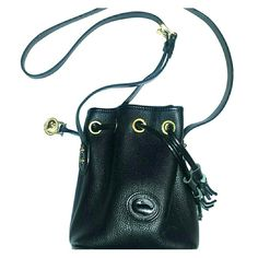 Vintage Dooney and Bourke Mini drawstring!! Authentic black leather and brass mini drawstring. Shows very minimal scuffs to corner. No flaws rips or stains,very clean and we'll taken care of. Great condition to be a vintage!! Dooney & Bourke Bags Crossbody Bags