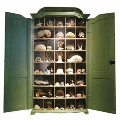 love the natural look!  All things nature oriented is a fabulous look arranging inside a cabinet