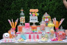 Classic, easy, eye catching, and simple. Candy Table - lovely idea for a girl's bday party