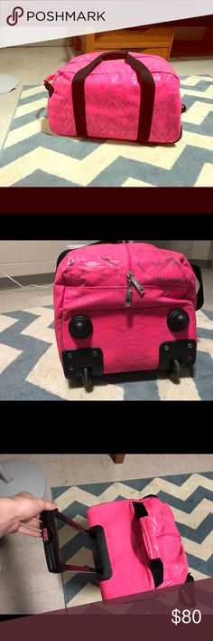 Victoria's Secret PINK Suitcase/Duffel Bag I just got it a couple years ago. It's super nice, fits everything I needed for a week long vacation and I use it for sleepovers sometimes. There is some dirt on it from airports (I travel a lot) but I'm going to clean it up and take some more pictures. No rips or tears or stains unless the dirt doesn't come out. There is a matching make up bag and smaller bag if you are interested! PINK Victoria's Secret Bags Travel Bags