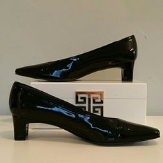 Stuart Weitzman Patent Pumps Beautiful  pumps in patent black leather.  Amazingly comfortable.  Truly a classic shoe.  Excellent condition.   2inch heels. Stuart Weitzman Shoes Heels