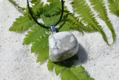 Pretty tumbled white howlite stone necklace. The tumbled white howlite stone is a pendant on a genuine leather cord necklace with a lobster clasp.