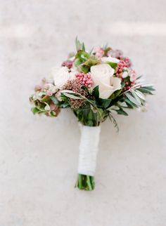 Rose wedding bouquet: Flowers: Yucca Flowers - http://www.stylemepretty.com/portfolio/yucca-flowers Photography: Les Anagnou photographers - www.lesanagnou.com Read More on SMP: http://www.stylemepretty.com/destination-weddings/2017/03/20/a-breathtaking-cliff-ceremony-overlooking-the-aegean-sea/