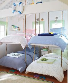 "What a cute and clever space saving idea for a cottage or beach house: ""bunk bed room"" with hanging bunk beds!"