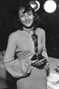 Luise Rainer, the first woman to win two Oscars back to back, holds her Best Actress award for her performance in The Great Ziegfeld during the 1937 Academy Awards ceremony.