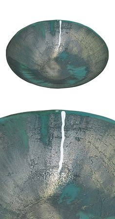Anchor a beloved rustic contemporary table with this gorgeous Aquatic Bowl. This gorgeous glass dish is covered in a sparkling silver and aqua colored finish. Fill this beautiful bowl with a stunning a...  Find the Aquatic Bowl, as seen in the Decorative Bowls Collection at http://dotandbo.com/category/decor-and-pillows/vases-and-trays/decorative-bowls?utm_source=pinterest&utm_medium=organic&db_sku=124658