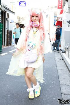 Present - Here's Monta, a Harajuku Fashion Walk participant and amateur idol who we snapped on the street in Harajuku. Her outfit here features cat ears, pink hair, lots of decora accessories, Hello Kitty shoes & an Angelic Pretty heart bag. Check all of her closeups & info: http://tokyofashion.com/cat-ears-pink-hair-flowers-hello-kitty-angelic-pretty-harajuku/ (Tokyo Fashion. 2012)