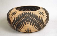 Native American Baskets Made at the turn of the 20th century, this Native American coiled basket depicts a striking graphic pattern in black and white.